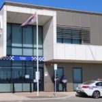 "A police station/office along with the australian flag and a police car, which is header image of the blog entitled ""charged with criminal offence""."