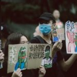 Hong Kong protesters wearing facemasks and their boards to devoid of a legal system.
