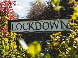 """Closed-up of signage that says """"LOCKDOWN"""" that represents the """"pregnant anti-lockdown organiser arrested"""" blog."""