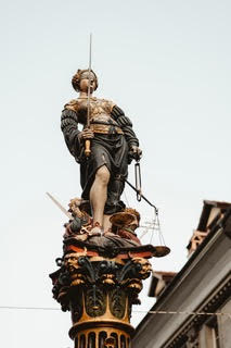 """A lady justice statue that talks about the """"convicted with appeal pending""""."""