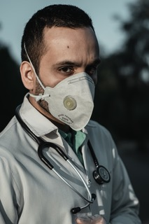 "A doctor wearing mask, from the blog post ""client-lawyer costs during covid-19""."