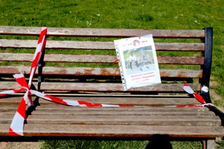 """Park bench with crime scene line with a picture that represents the """"park benches crime scenes"""" blog."""