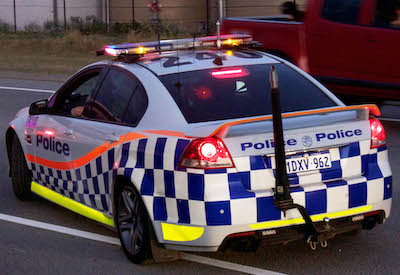 "WA Police car on a road and that represents the ""police charges and roles"" blog."