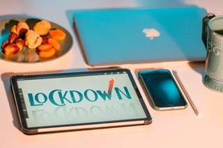 """Mobile, tablet with Lockdown screen and iPad devices on a table and that represents the """"perth covid lockdown and court's respond"""" blog."""