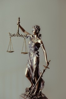 """Small lady justice figure and that represents the """"perth post covid lockdown and court's respond"""" blog."""