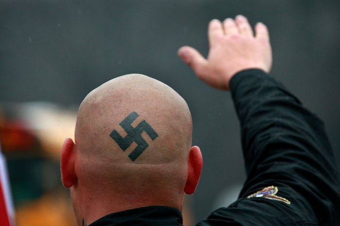 """Nazi logo tattoo on a man's head and that represents the """"mental illness or impairment murder case"""" blog."""