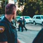"""Police officer looking back on his 2 co-workers arresting a person and as the featured image of """"derek michael chauvin's jury verdict and sentencing"""" blog."""