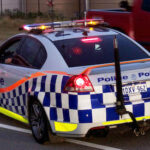 """A police car on a road and as the featured image of """"safewa police data access"""" blog."""