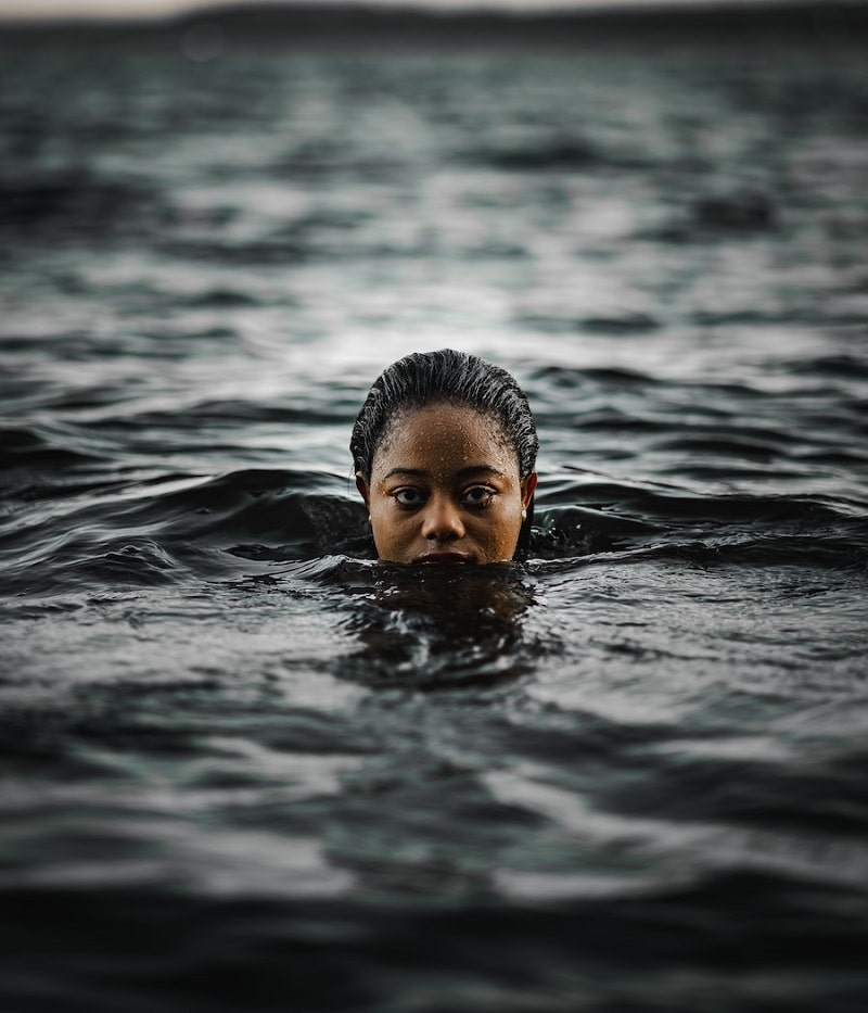 """Closed-up of a woman floating on a sea-water and as the featured image of """"abuse and sexual complaints swimming australia"""" blog."""